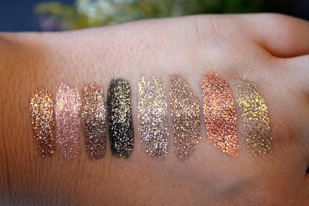 From Left to Right: Kitten Karma, Ballet baby, smoldering satin, Molten Midnight, Diamond Dust, Smoky Storm, Rose Gold Retro, & Gold Goddess